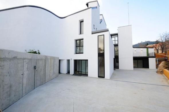 Casa Dels Xuklis realizado / MBM Architects