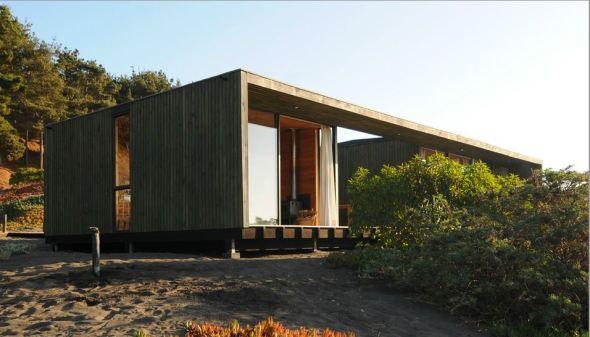 La madera utilizada de la forma más elemental para un acogedor diseño. Casa Chagual.