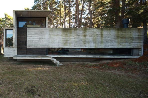 Vivienda con muebles de concreto: Casa Pedroso